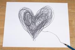 Сердце нарисованное карандашем на бумажном листе Стоковая Фотография
