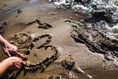 Сердце на песке стоковое фото rf