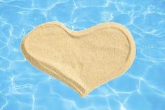 Сердце песка стоковые изображения