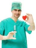 сердце руки доктора его шприц Стоковая Фотография RF