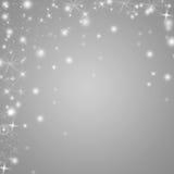 Серебряная и белая предпосылка зимних отдыхов с звездами и снежинками Стоковые Фото