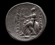 Серебряная монета древнегреческия на черноте Стоковые Фотографии RF