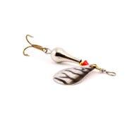 Серебряная ложка рыбной ловли на белизне Стоковая Фотография