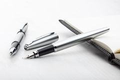 Серебряная ручка авторучки и ролика Стоковые Изображения RF