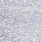 Серебряная сияющая текстура, серые sequins с предпосылкой нерезкости Стоковые Фото