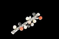 Серебряная фибула в форме ветви Стоковая Фотография