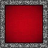Серебряная флористическая рамка на красной предпосылке бархата Стоковые Фото