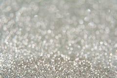Серебряная яркая предпосылка bokeh яркого блеска Стоковое Изображение RF