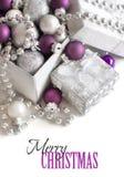 Серебряное и фиолетовое рождество орнаментирует границу Стоковые Фотографии RF