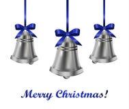 Серебряные колоколы с голубым смычком Стоковое Фото