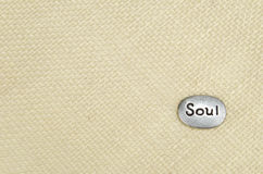 Серебряный камень души на мешковине Tan Стоковые Изображения RF