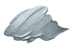Серебряный ход кисти или абстрактный мазок лиманды с серебряной текстурой smudge яркого блеска на белой предпосылке Изолированное Стоковые Изображения