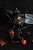 Серебряный чайник и бокал вина Стоковые Фотографии RF