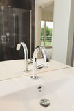 Серебряный armature в ванной комнате стоковое фото rf