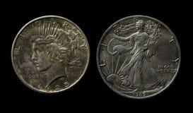 2 серебряных американских доллара на черноте Стоковые Изображения