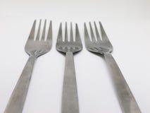 3 серебряных вилки на белизне Стоковая Фотография