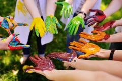Серии рук в краске в круге Стоковые Изображения RF