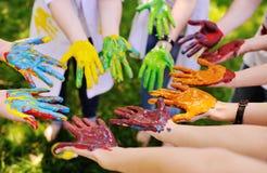 Серии рук в краске в круге Стоковое фото RF