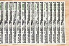 Серия денег на деревянной предпосылке Стоковые Изображения