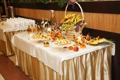 Серия еды на таблице Стоковое Изображение