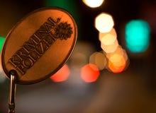 Серия Policel перед светами города к ноча стоковая фотография