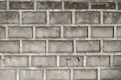 Серое фото крупного плана кирпичной стены для предпосылки Поверхность бетонной плиты Грубый серый каменный кирпич Стоковые Фото