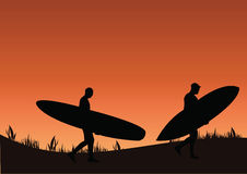 серферы захода солнца Стоковая Фотография RF