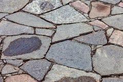 Серые вымощая камни как предпосылка Стоковые Изображения