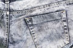 Серые джинсы с стежками и карманн, предпосылкой фото Джинсовая ткань джинсов Boho Стоковое Изображение RF