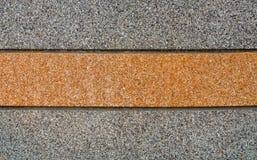 Серые и оранжевые каменные предпосылка и текстура Стоковая Фотография RF