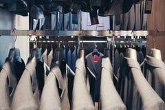 Серые костюмы стоковая фотография