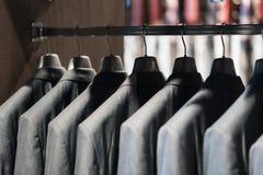 Серые костюмы стоковые фото
