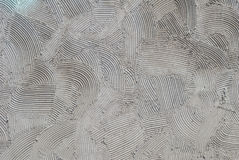 Серый декоративный гипсолит сброса на стене, текстуре предпосылки Стоковые Фото