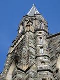 Серый каменный Steeple церков Стоковое Изображение