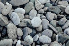 Серый конец-вверх камней Предпосылка Minimalistic каек пляжа Стоковая Фотография
