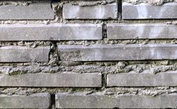 Серый крупный план текстуры и предпосылки кирпичной стены стоковое фото rf
