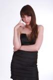 Серьезная девушка в черноте Стоковая Фотография RF