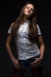 Серьезная женщина в рубашке стоковые изображения rf