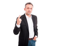 Серьезный бизнесмен держа его палец пересеченный Стоковое фото RF