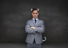 Серьезный бизнесмен представляя демона Стоковое фото RF
