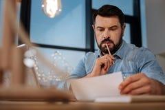 Серьезный заботливый дизайнер сдерживая его карандаш Стоковая Фотография RF