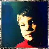Серьезный мальчик Стоковые Изображения