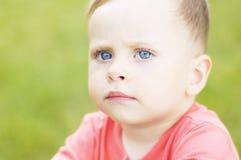 Серьезный малый мальчик Стоковые Изображения