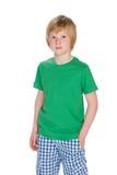Серьезный молодой мальчик на белой предпосылке Стоковые Изображения RF