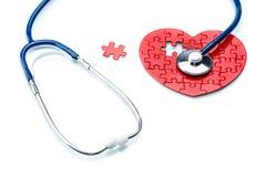 Сердечная болезнь, сердце головоломки с стетоскопом Стоковое Изображение
