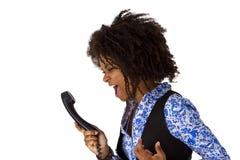 Сердитая женщина афроамериканца с телефонной трубкой Стоковая Фотография RF