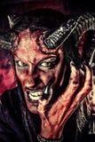 Сердитое satan Стоковые Фото