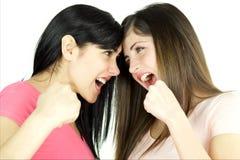 Сердитые девушки готовые для того чтобы пробить изолированный один другого Стоковая Фотография