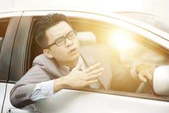 Сердитый азиатский водитель Стоковое Фото