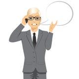 Сердитый белокурый бизнесмен имея переговор иллюстрация штока